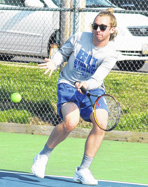 Washington's Ryan Elrich makes the return during a first singles match against Greeneview Tuesday, April 6, 2021 at the courts at Gardner Park.