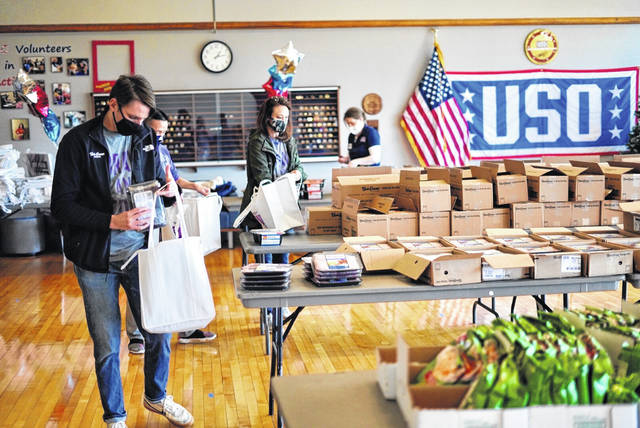 Bob Evans Farms partnered with the Wright-Patterson AFB USO Center to donate 250 grocery bags to military families. The donation was held as a drive-up meal event.