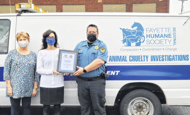 Fayette Regional Humane Society (FRHS) chief humane agent, Brad Adams, received the Humane Law Enforcement Award from the Humane Society of the United States and the National Law Enforcement Center on Animal Abuse. Adams received this award for his leadership in combating illegal animal abuse and is the only member of the law enforcement community in Ohio to receive this award in 2021. Pictured (left-to-right) are FRHS Executive Director Lee Schrader, Humane Society of the United States Ohio Director Corey Roscoe, and Adams.