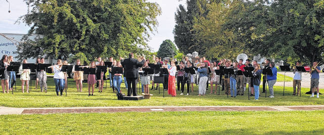 The Washington High School Band, directed by Matt Stanley, played music during the Memorial Day service at Washington Cemetery on Monday.