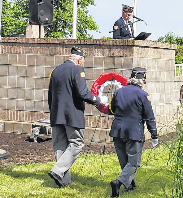 Veteran Service Commissioners Edward Fisher and Patricia DeWees presented the wreath during the days services.