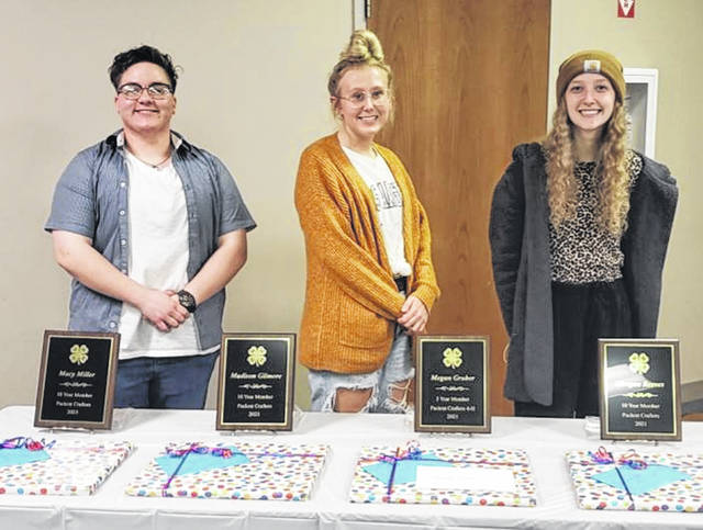 The Packrat Crafters 4-H club recently recognized and celebrated three of their graduating members: (left-to-right) Macy Miller, Madison Gilmore and Morgan Reeves.