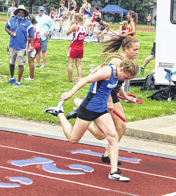 Washington's Chloe Lovett leans at the finish line for third place .06 of a second ahead of Circleville in the 4 x 400-meter relay at the Division II District meet Saturday, May 22, 2021.