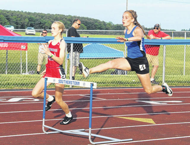 Washington's Chloe Lovett clears a hurdle in the 300-meter event at the Regional meet at Southeastern High School Thursday, May 27, 2021. She will compete in the finals Saturday afternoon. Also pictured is Claire Shriner of Sheridan.