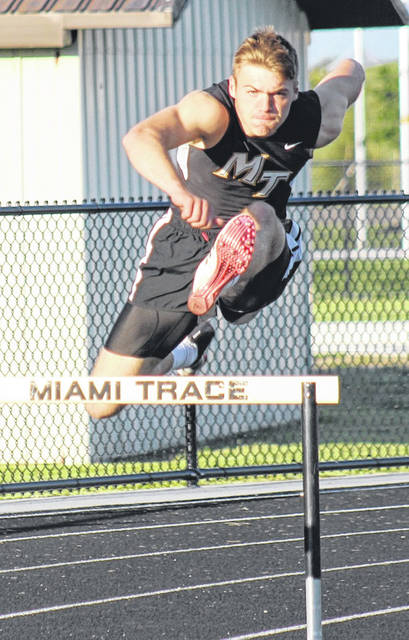 Miami Trace's Jaden Haldeman clears a hurdle in the 300-meter event at the Frontier Athletic Conference tournament Thursday, May 13 at Miami Trace High School. Haldeman won this event, setting a new FAC record in 39.20. Please see today's sports for more coverage of the FAC track meet.