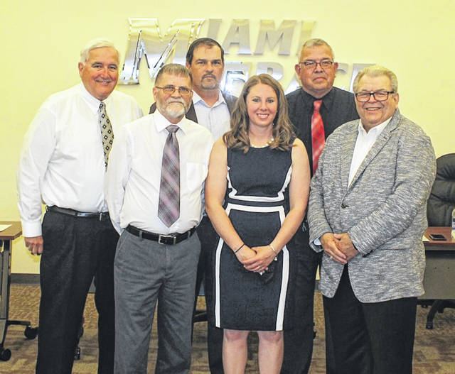 Kayla Dettwiller was approved by the Miami Trace Local School Board by a 5-0 vote on Monday, May 10, 2021 as the new girls' varsity basketball head coach. Dettwiller is joined by board members (l-r); Mike Henry, David Miller, Rob Dawson, Charlie Andrews and Bruce Kirkpatrick.