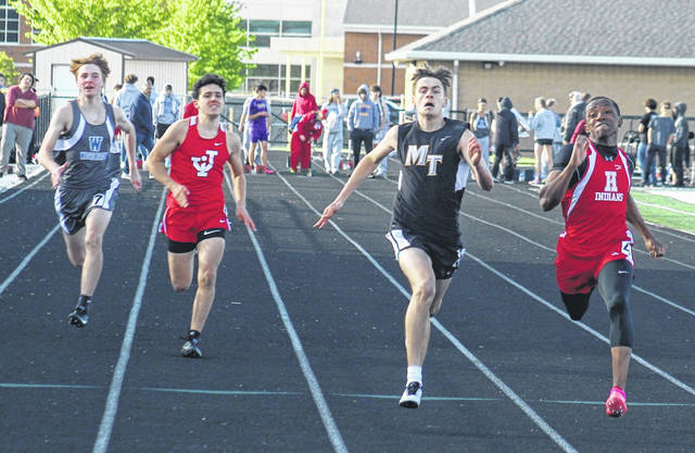 Miami Trace's Jadon Rowe (third from left) runs with (l-r); Trae Patton, Washington; Keon Koka of Jackson and Kai Rickman of Hillsboro in a heat of the 100-meter dash at the FAC meet Tuesday, May 11, 2021 at Miami Trace High School. Rowe and Rickman advanced to the finals in the event. The finals will be held Thursday, starting at 5 p.m.
