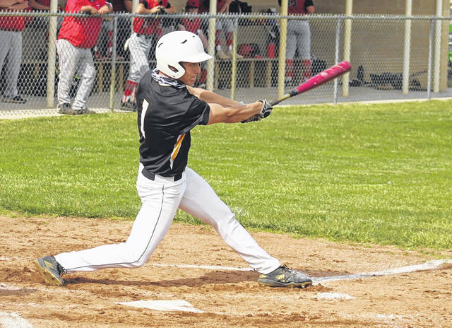 Miami Trace senior Josh Gilmore hits a sacrifice fly during the first inning of a Division II Sectional semifinal baseball game against Logan Elm at Miami Trace High School Tuesday, May 18, 2021.