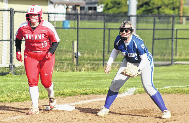 Washington's Makenna Knisley, at right, holds a Hillsboro runner close at third base during a Frontier Athletic Conference doubleheader at Washington High School Wednesday, May 5, 2021.