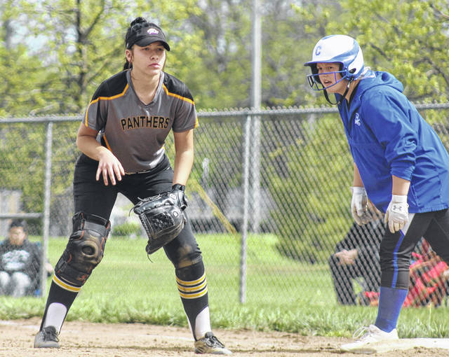 Miami Trace senior Piper Grooms (at left), is ready for the play as a Chillicothe runner stands at first base during a Division II Sectional tournament game at Miami Trace High School Saturday, May 8, 2021.