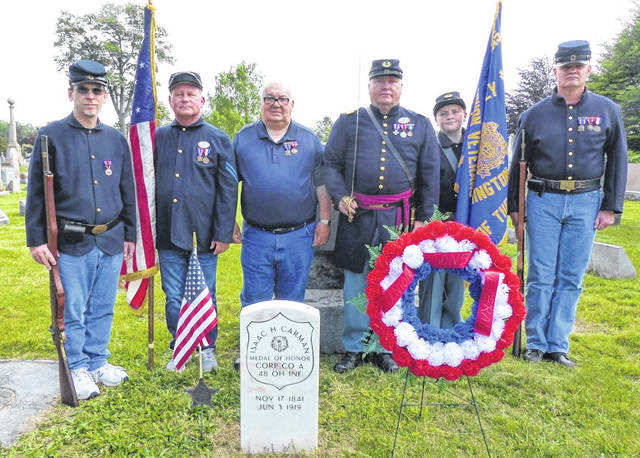 Henry Casey Camp No. 92 Sons of Union Veterans of the Civil War (SUVCW) placed Memorial Day wreaths on the graves of the four Civil War Medal of Honor recipients buried in Fayette County; plus, the grave site of the last surviving Civil War veteran. Pictured at the grave site of Medal of Honor recipient Corporal Isaac Carman are (left to right): Shawn A. Cox, Christopher S. Grim, Charles Rose, Shane L. Milburn, Jordan Milburn and Kelly Hopkins.