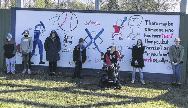 Recently, Washington Court House City School students submitted and then painted designs for murals at the Little League Complex in Washington C.H. Pictured are middle school muralists (left-to-right): Hayden Lester, Wesley Gibbs, Scotti Quigley, Julyen Ryan, Joel Buyer, Nicoal Penrod, and Danica Haithcock. Not pictured are Tami Rose (WMS art teacher), Miranda Bailey (Aide) and Sonja Smith (Aide).
