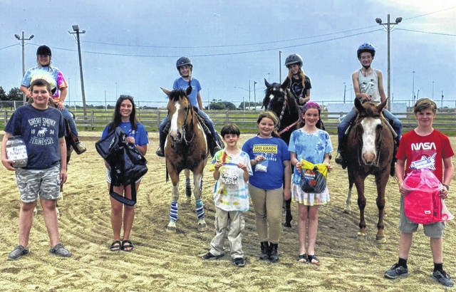 All-N-One 4-H Club collected and donated old cell phones to the Fayette County Prosecuting Attorney's Office Victim Witness Division, pop can tabs to Ronald McDonald House, old eye glasses to the Good Hope Lions Club and books bags/socks to the Fayette County Children Services. Participating members were: (L to R on horses) Caitlyn Ford, Molly Payton (co-community service officer), Rachel Brown and Taylor Payton (co-community service officer). Front row (L to R): Logan Payton, Madison Johnson, Calvin Reed, Taylor Matthews, Megan Reed and Nathan Reed.