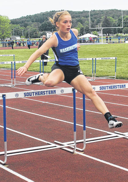 Washington's Chloe Lovett goes over the hurdle in the 100-meter finals at the Division II Regional meet at Southeastern High School near Chillicothe Saturday, May 29, 2021.