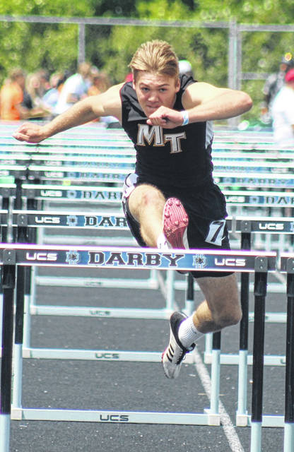 Miami Trace High School recent graduate Jaden Haldeman bears down on the final hurdle in his heat of the 110-meter event at the Division I State track meet at Hilliard Darby High School Friday, June 4, 2021. Haldeman placed 11th out of 17 in the event with a time of 14.83. Later Friday afternoon, Haldeman competed in the 300-meter hurdles, placing 10th out of 17 competitors with a time of 39.18.