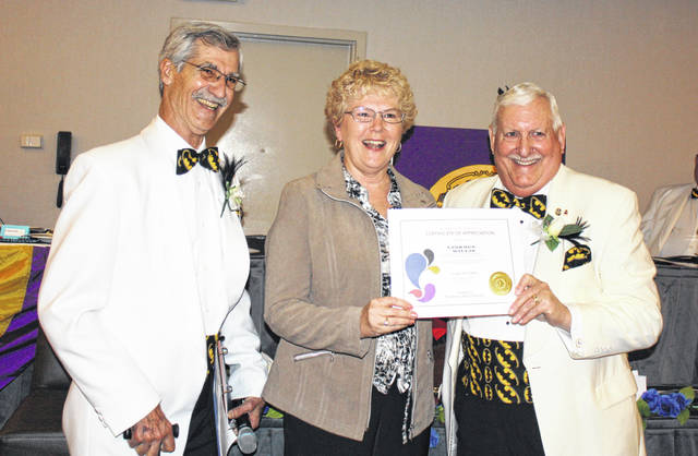 Two members of the Washington Court House Lions Club recently received the International President's Certificate of Appreciation. The first was WCH Lion Sue Willis. Pictured (L to R): OH-6 District Governor Ric Houser, Willis and International Director Geoffrey Wade of Florida.