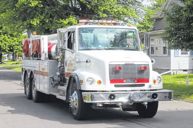 With horns blaring and lights spinning, residents had a chance to see the various volunteers of the Jefferson Township Fire and EMS as they honored the fallen for Memorial Day.