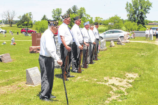 Honor Guard members from Frankfurt took part in the service and stood at attention to honor their fallen brothers and sisters at the New Holland Cemetery.