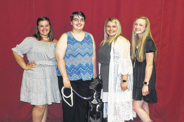 The 2021 Fayette County Queen's Tea was held Thursday evening at the Mahan Building with a variety of guests. This year the Fayette County Fair Queen will be selected from a field of four candidates. All four candidates were in attendance Thursday evening and the judges for the Queen selection said each brought their best and will make their job of selecting the Queen quite difficult. Pictured (L to R) are the candidates: Abigail Mick, Katrina Koski with her service dog Phoenix, Taylor Moore and Garren Walker.