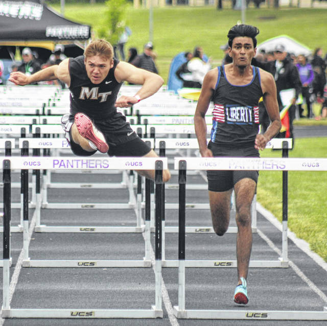 Miami Trace's Jaden Haldeman, at left, clears the last hurdle in the 110-meter finals at the Division I Regional meet at Pickerington North High School Friday, May 28, 2021. Also pictured is Anirudh Banda of Olentangy Liberty. Haldeman received an at-large bid to compete at the State meet at Hilliard Darby High School Friday at 2:45 p.m.