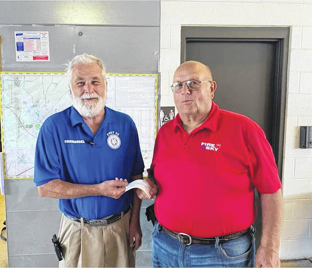 American Legion Post 25 recently made donations for area fireworks. Pictured is American Legion Post 25 Commander Glenn Rankin (left) presenting a check to Tom McMurray for Fire in the Sky.