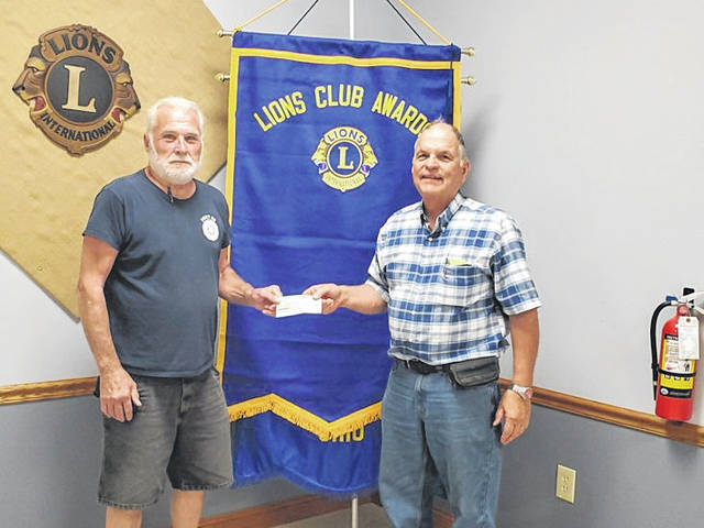 American Legion Post 25 Commander Glenn Rankin recently presented a check to Larry Schriver, president of the Jeffersonville Lions Club, for their fireworks on July 4 in Jeffersonville.