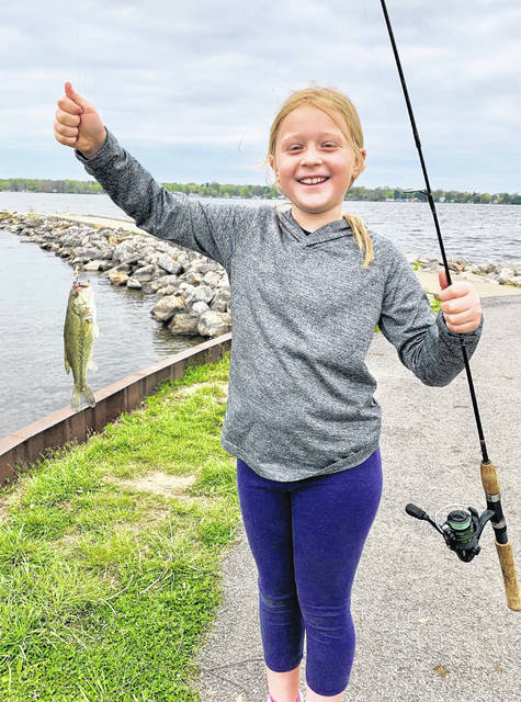 The ODNR recently announced that Ohio residents may fish for free in any of Ohio's public waters, including Lake Erie and the Ohio river Saturday and Sunday, June 19-20. Pictured is a young fisher woman.