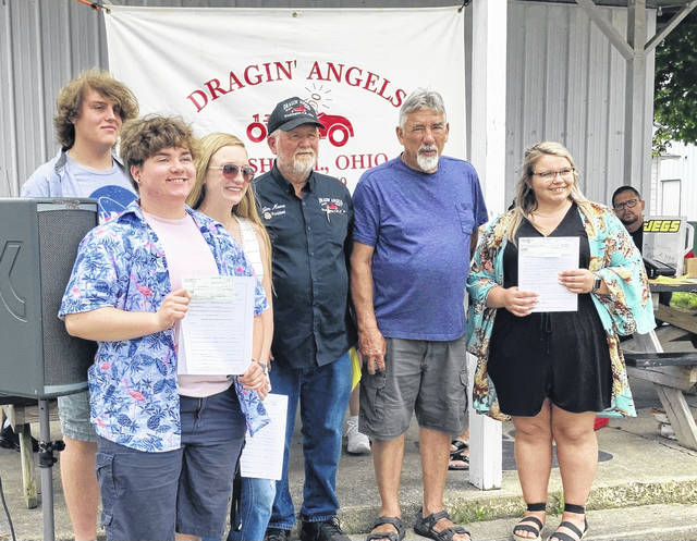 Several scholarships were gifted to graduating local seniors by the Dragin' Angels. Pictured (back): Hayden Brown, (left-to-right, front): Macy Miller, Garren Walker, President Jim Moore, Vice President Leonard Wheatcraft, and Taylor Moore. Not pictured: Ethan Steele and Cherokee Lifino.