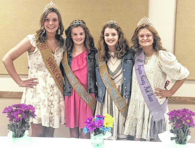 Libby Aleshire (left) was recently crowned the 2021 Swine Industry Queen while both Emma Bower and Emma Hagler were named 2021 Swine Industry Princesses. The individuals were crowned by outgoing 2020 Swine Industry Queen Laikyn Hughes (right).