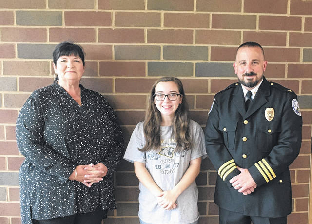 Attending the presentation of the City of Washington Court House Police Department Scholarship are: (L to R) Jessica Wise, Ph.D., SSCC Dean of Instructional Operations and Director of Fayette Campus; scholarship recipient Makayla Lingerfelt; and Chief Jeff Funari.