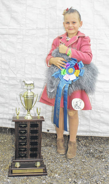 Ali Swigert, above, daughter of Chad and Amanda Swigert, won the Class 3 division of the Guys and Gals Sheep Lead at the 2021 Fayette County Fair Monday, July 19.