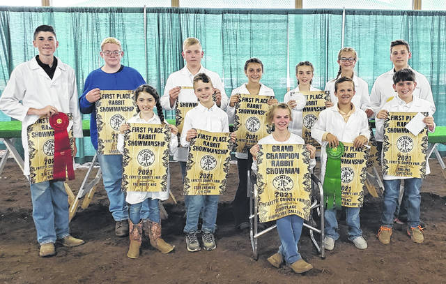 The Fayette County Junior Fair Rabbit Showmanship contest took place in the small animal barn at the Fayette County Fairgrounds on Monday. Lindsey Stump (seating) was Grand Champion Rabbit Showman and is pictured with other class winners.