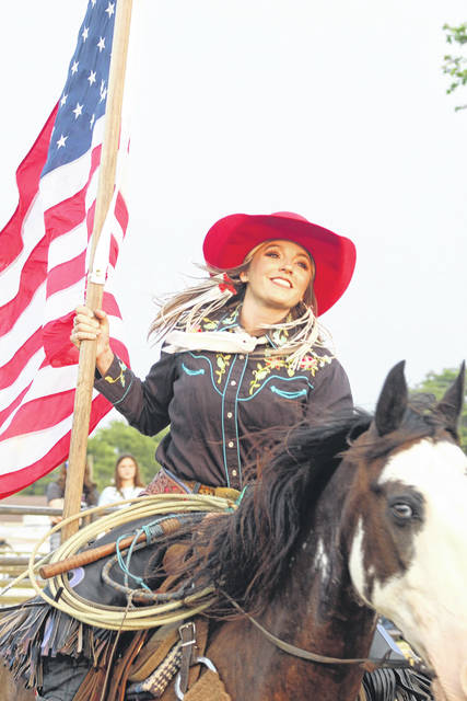 This young lady carried the Stars and Stripes at the start of the rodeo at the fair Monday, July 19, 2021. A large crowd turned out for the event at the grandstand.