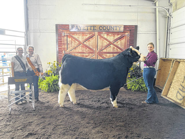 Victoria Waits was named the overall beef showman on Tuesday following the Fayette County Junior Fair Beef Show. Waits also claimed the grand champion steer title on Tuesday. Pictured (L to R): Fayette County Goat Ambassador Emma See, Fayette County Beef Queen Gracelyn Zimmerman and Waits.