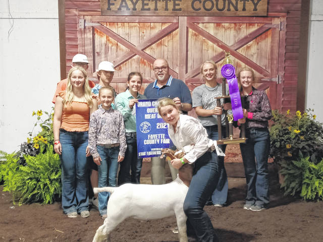 Maya McCoy won the 2021 Overall Grand Champion Meat Goat prize late Tuesday evening. Pictured (L to R): Reagan Gross, Zander Ivey, Alli Knecht, Gus Wilt, Kelsey Pettit, judge Terry Burks, McCoy, Jordan McCoy, and Mara Simonson.