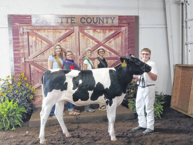 River Havens was the junior champion showman and reserve overall showman on Friday. He is pictured with Fayette County Swine Queen Libby Aleshire, Fayette County Fair Queen First Attendant Taylor Moore, Fayette County Dairy Princess Alexis Gardner and Fayette County Goat Ambassador Emma See.