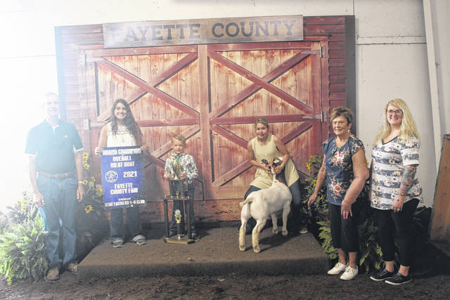 Maya McCoy's grand champion meat goat sold for $1,750 at Saturday's Fayette County Fair Meat Goat Sale. The buyers for the meat goat were: EZ Oil, Fayette Veterinary Hospital, McDonald & Son Feeds, Buckeye Illini Genetics, Faris Insurance, Judge Victor Pontious, and K&S Concrete.