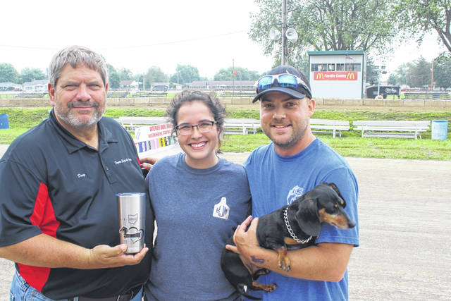 The first Wiener Dog Races were held this year at the Fayette County Fair and were divided into three heats for the preliminary races. The winner of the first heat was Turbo. He is pictured with Fayette County Senior Fair Board Vice President Doug Marine, Kaytlyn and Trevor Justice.