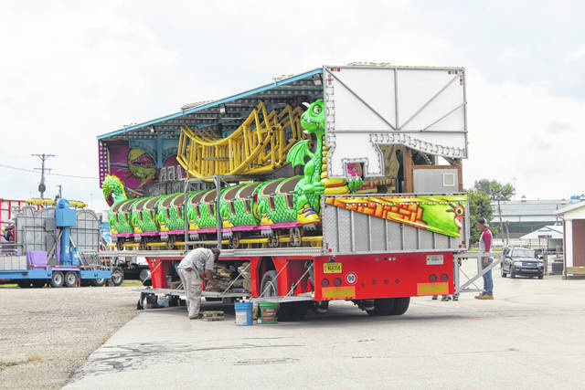PrimeTime Carnival Company employees could be seen on Tuesday at the Fayette County Fairgrounds preparing to set up the rides for the fair next week. The 142nd Fayette County Fair will be held from July 19-24 with an opening ceremony taking place on Sunday at 2:30 p.m. at the McDonald's Grandstand.