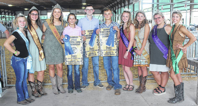 The Fayette County Junior Fair Swine Breeding Show and Showmanship was held on Monday afternoon. Pictured are the three showmanship winners from the first shows of the day. Pictured (L to R): Fayette County Small Animal Queen Lindsey Stump, Fayette County Lamb and Wool Queen Abbie Brandt, Fayette County Swine Queen Libby Aleshire, Junior Breeding Showmanship winner Alison Reeves, Senior Breeding Showmanship winner Zander Ivey, Intermediate Breeding Showmanship winner Aiden Knecht, Fayette County Fair Queen Garren Walker, Fayette County Swine Princess Emma Bower, Fayette County Fair Queen First Attendant Taylor Moore and Fayette County Dairy Princess Alexis Gardner.