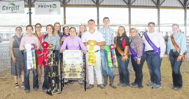 The 2021 Fayette County Junior Fair Showman of Showmen Contest was held on Friday afternoon with 13 exhibitors. Kelsey Pettit won the top honor for the day and was named the overall Showman of Showmen. Pettit, who qualified for the contest by being named top goat showman, was pleased to see her hard work pay off and was glad to win overall following the second place she received last year. Pettit thanked her parents and best friend for their continual support. Pictured (L to R): Fayette County Goat Ambassador Emma See, third overall showman of showmen Emily Reeves, Fayette County Lamb and Wool Queen Abbie Brandt, second overall showman of showmen Madison Johnson, Fayette County Swine Queen Libby Aleshire, Fayette County Fair Queen Attendant Abigail Mick, overall Showman of Showmen Pettit, Fayette County Fair Queen Garren Walker, fourth overall showman of showman Bryce Bennett, fifth overall showman of showmen Robert Bennett, Fayette County Horse Queen Lorelei King, Fayette County Fair Queen First Attendant Taylor Moore, Fayette County Fair Queen Attendant Katrina Koski and Fayette County Beef Queen Gracelyn Zimmerman. See the Tuesday edition of the Record-Herald for more from the Fayette County Junior Fair Showman of Showmen content.