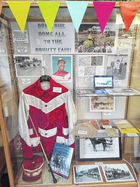 The Carnegie Public Library display case now features the local history of harness racing and the Fayette County Fair.
