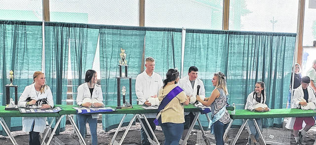 Pictured are overall winners during the Rabbit Meat Pen contest with Grand Champion Courtney Carter on the second-from-left and Reserve Champion Magarah Bloom on the far-left.