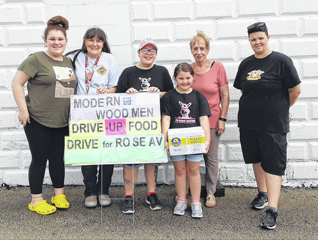 Modern Woodmen members collecting food and supplies at the Farmers' Market to benefit the Rose Avenue Community Center. Pictured (left-to-right):Market Volunteer Rilyn Jones, Woodmen volunteer Debra Grover, Market Vendor donor Kay Terry of KK's Waffle Barn with Madison Hay, Woodmen volunteer Ellie Dowler, and donor Kelly Hay. Not pictured: Rose Avenue volunteers Mark Michaels, Pastor Joy Stanforth, and Vernon Stanforth.