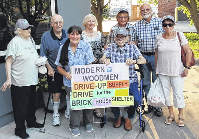 Modern Woodmen Members to sponsor a supply drive for the local Brick House Shelter. Pictured are members (left-to-right): Mary Ann Summers, Fred Summers, Debra Grover, Julia Curry, Ron Dowler, Bev Mayo, Dan May and Ellie Dowler.