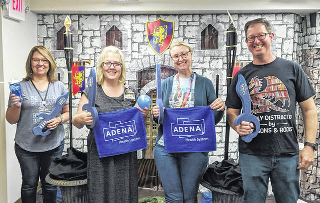 Carnegie Public Library staff is pictured with Adena Health System's Community Health Coordinator Lori Johnson (second to left) showing off some of the prizes available in this year's Summer Reading and Activity Challenge.