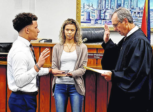 Jacob Rice was recently sworn in as a new officer of the Washington Police Department. Pictured (left-to-right) are Rice, his girlfriend Raven Haithcock and Washington Municipal Court Judge Victor Pontious.