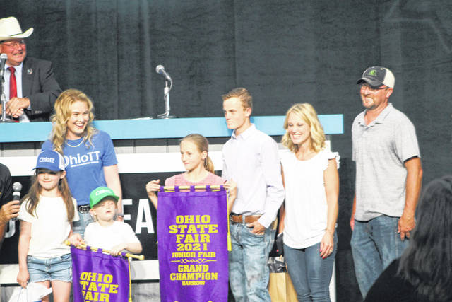 Aiden Knecht (pictured in the center of photo), of Fayette County, sold his grand champion market barrow at the Ohio State Fair for $55,000.