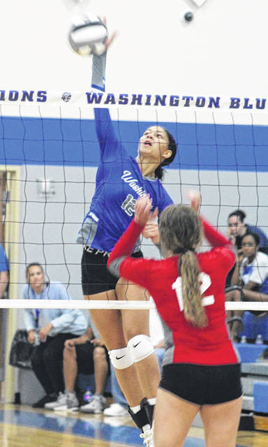 Jeleeya Tyree (12) makes the hit at the net for Washington during the season-opening volleyball match against East Clinton at Washington High School Wednesday, Aug. 25, 2021.