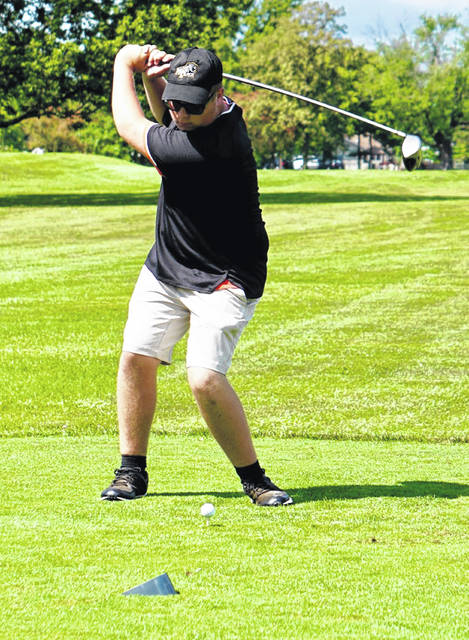Miami Trace's Kaden Noble tees off during a match against the Washington Blue Lions at The Greens Wednesday, Aug. 18, 2021.